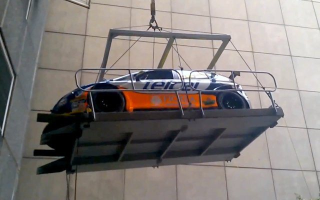 SEAT Leon Super Copa racing car dropped from crane